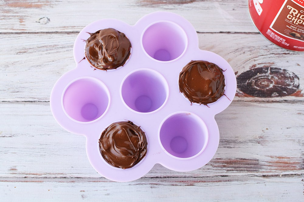 Three hot chocolate bombs in candy mold.
