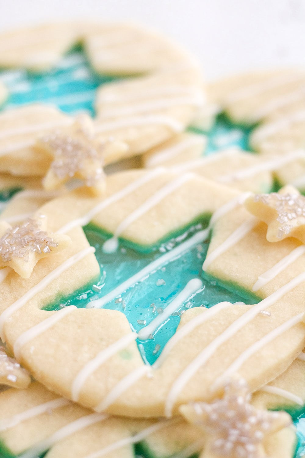 Jolly Rancher candy cookies with blue stars and white glaze.