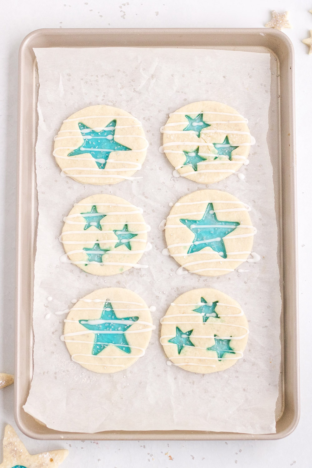 Star stained-glass cookies on a baking sheet ready for the oven.