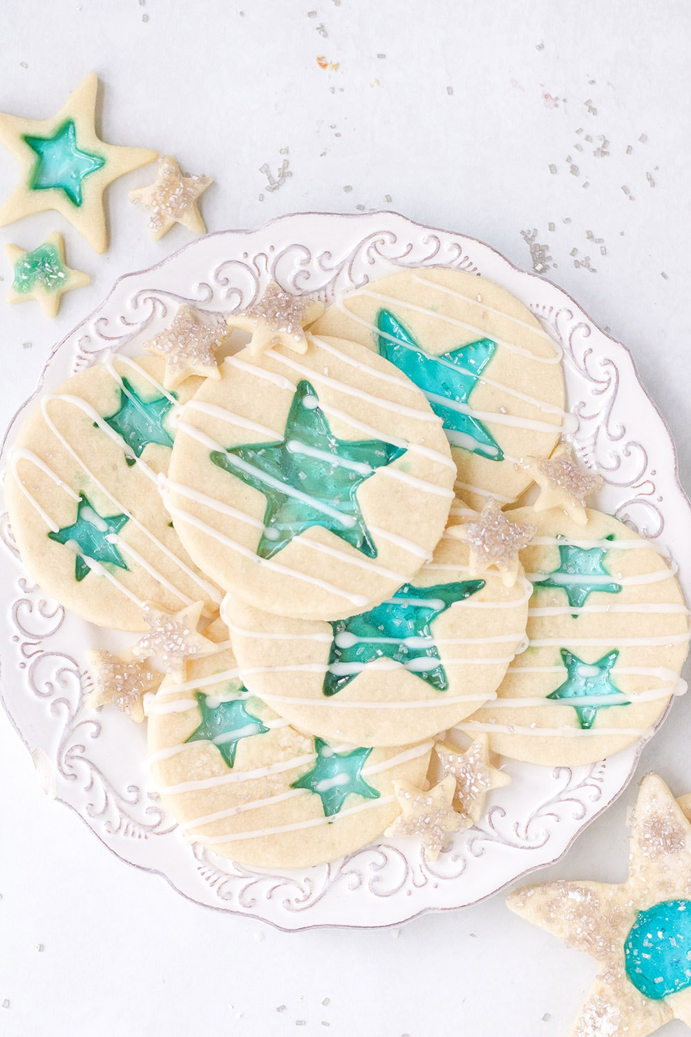 White plate of blue star cookies.