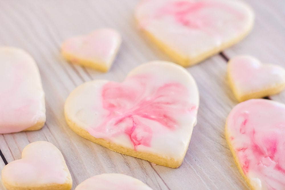 Pink icing on a heart sugar cookie.