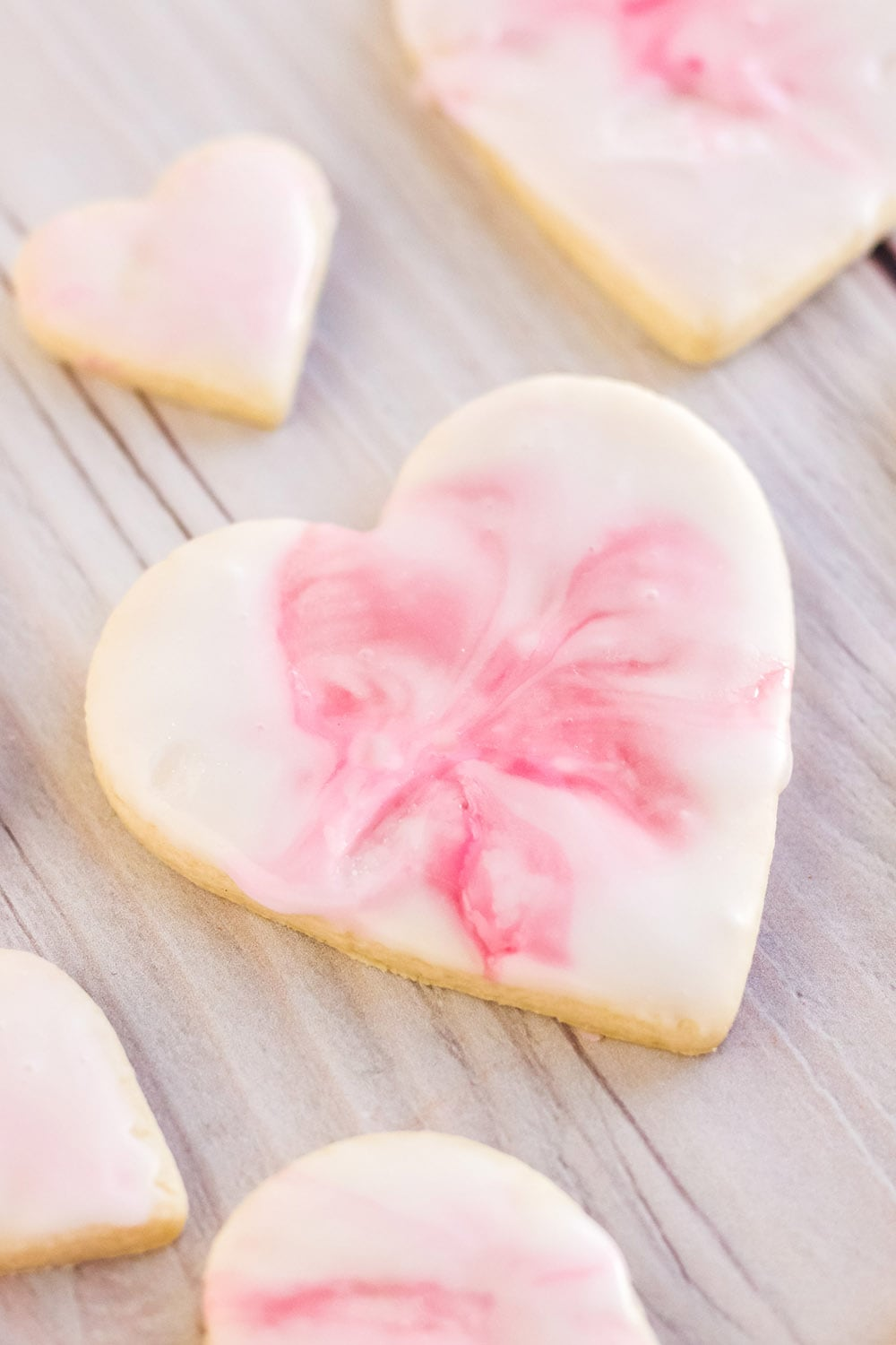 Valentine's day heart sugar cookies with pink marble icing.