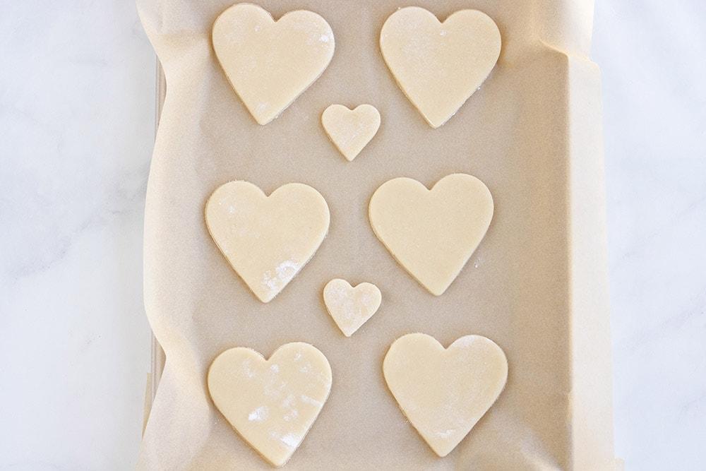 Sugar cookie hearts on baking sheet