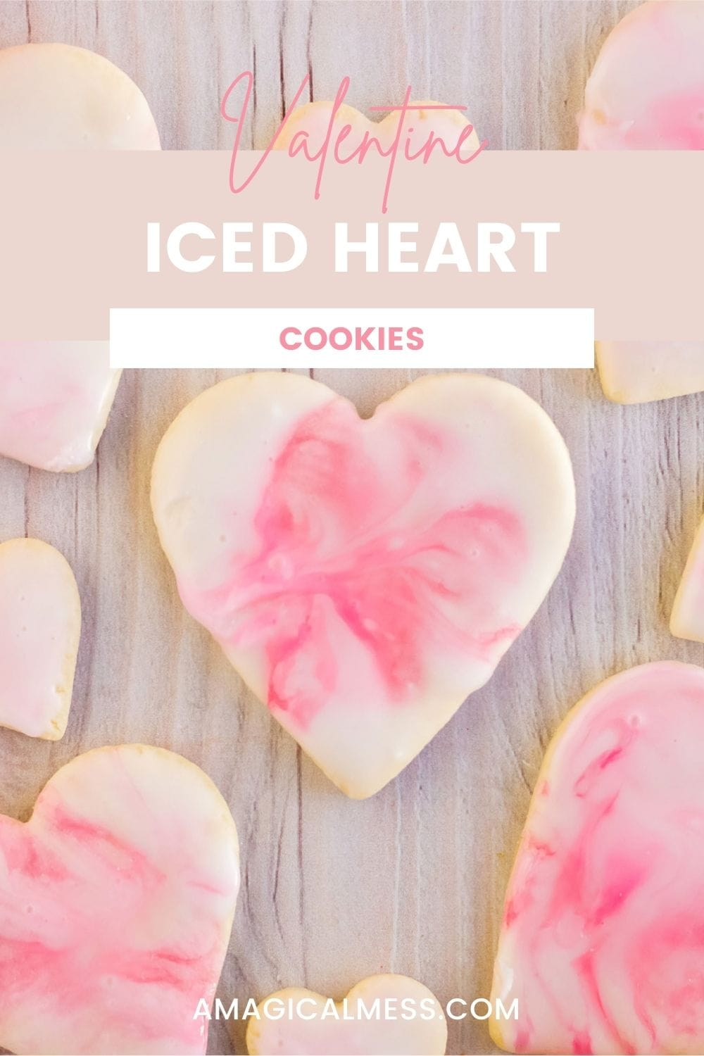 Heart shaped cookies with pink and white marble icing on a table.