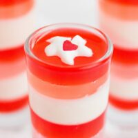 Top of layered jello with whipped cream dollop.