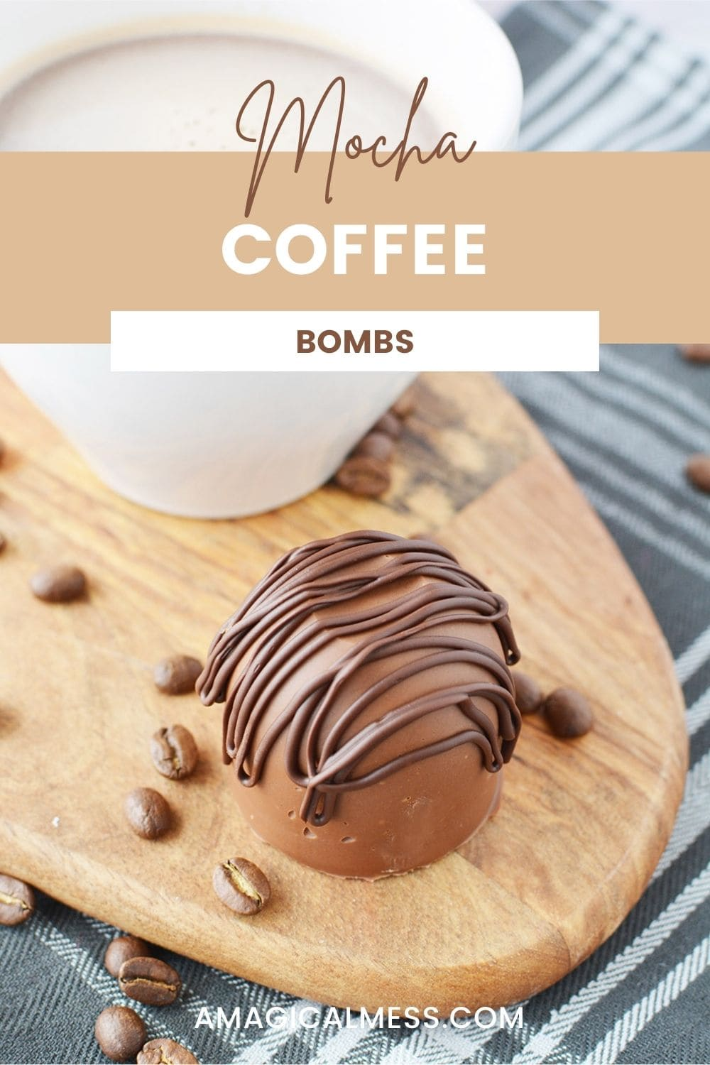 A coffee bomb sitting by coffee beans and a white mug.