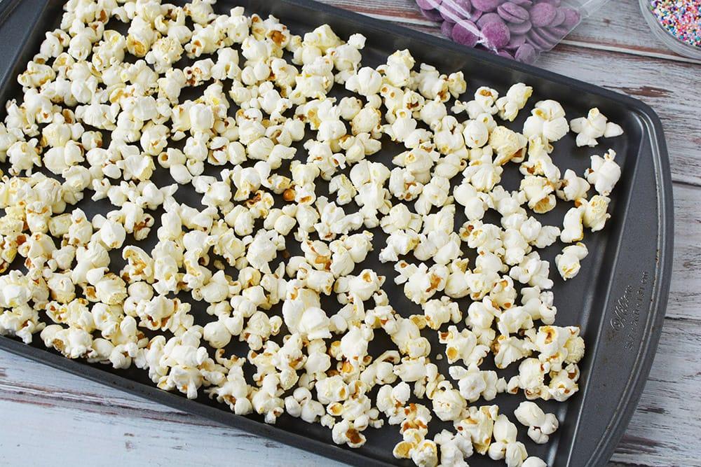 Popcorn on a baking sheet.