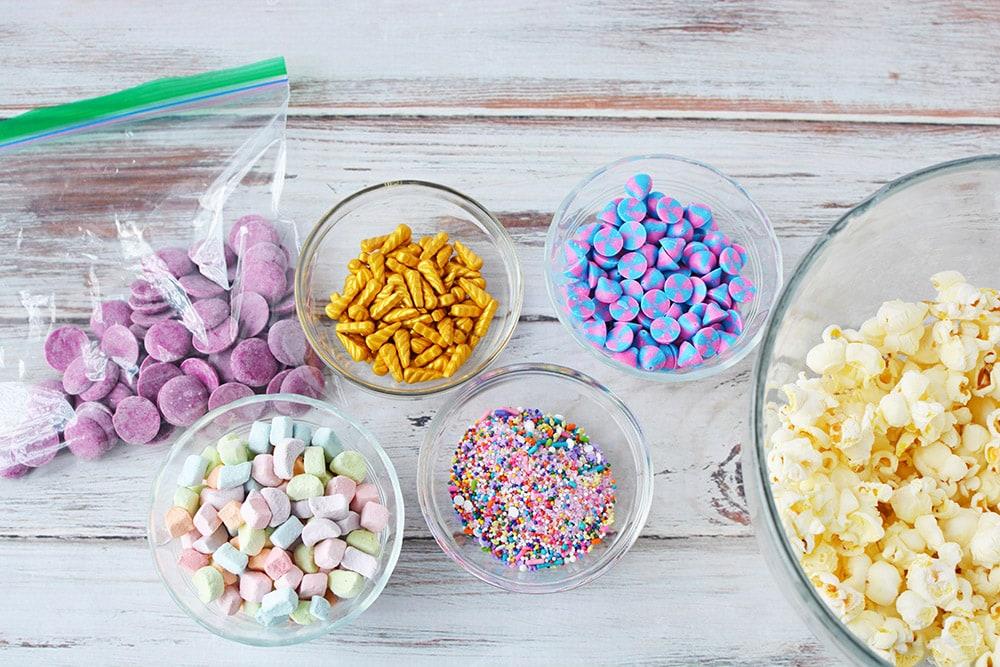 Bowls of ingredients to make unicorn popcorn.
