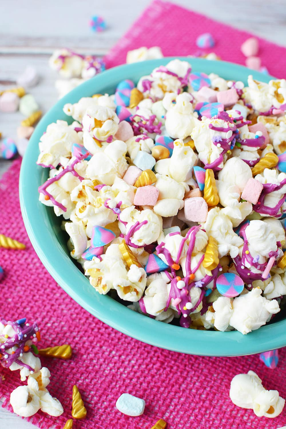Colorful popcorn in a blue bowl.
