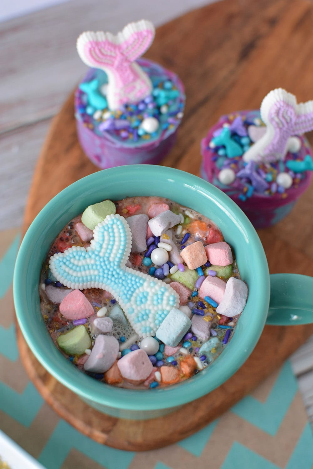 Mermaid tail floating in a mug of hot cocoa.