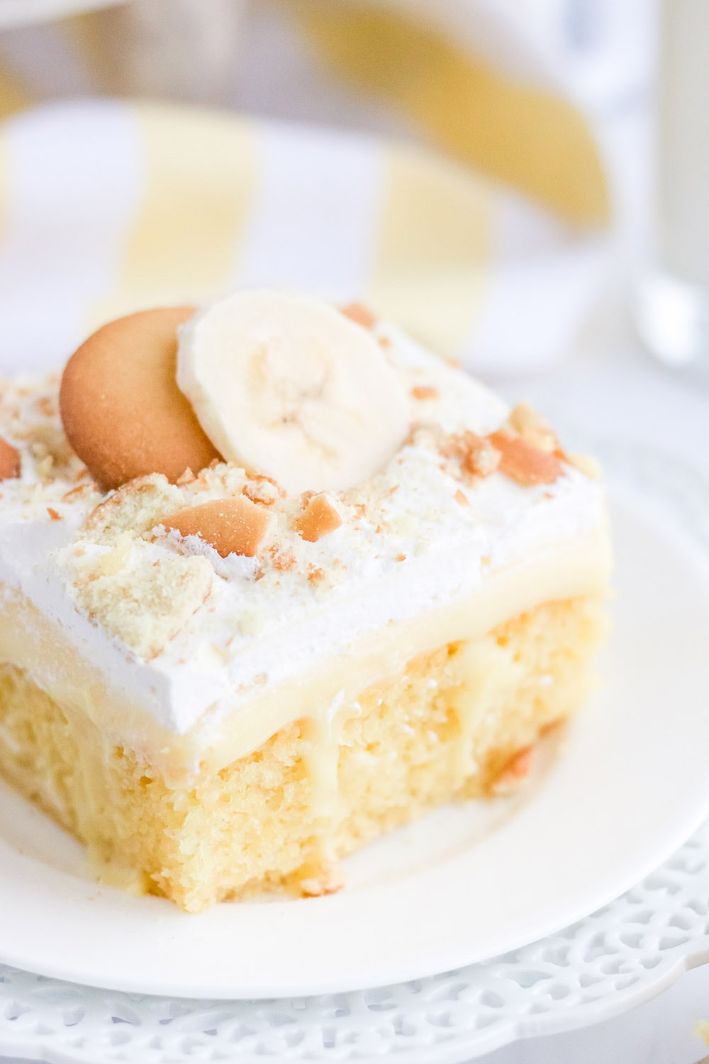 Banana cake with pudding topped with whipped cream and nilla wafers.