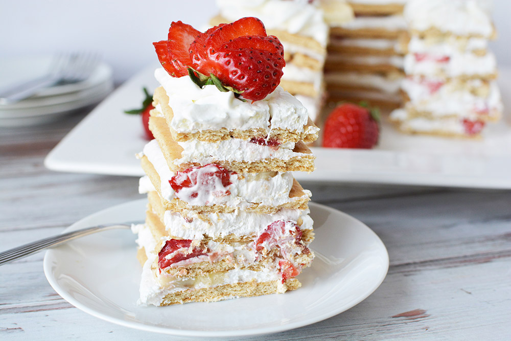 Stacked ice box cake with strawberries.