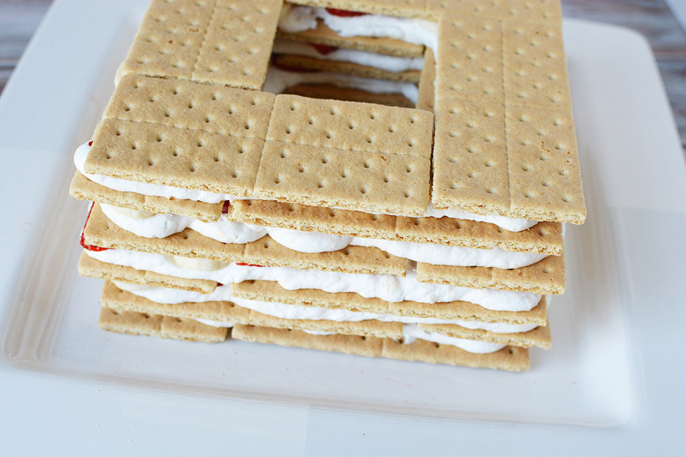 Layers of graham crackers, strawberries, and whipped cream.