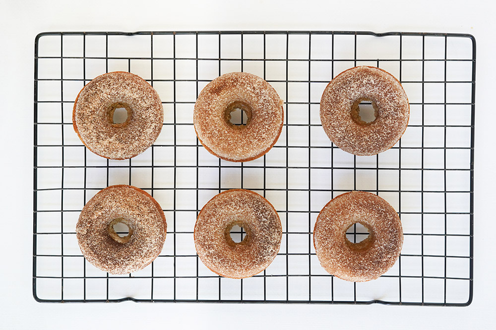 Donuts on a wire rack.