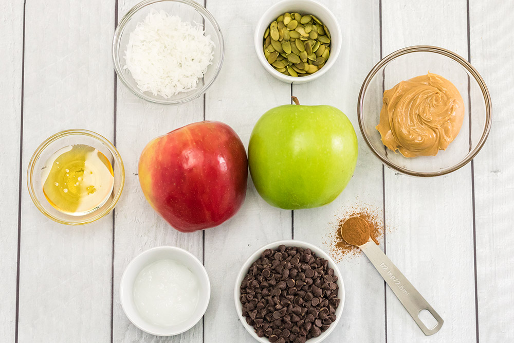 Apples, nuts, and other toppings for apple nachos.