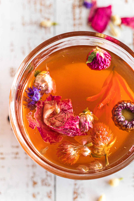Mug full of tea and flowers.