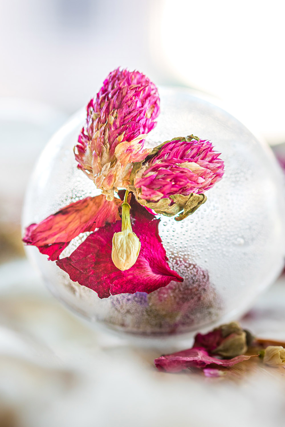 Clear tea globe with a pink flower.
