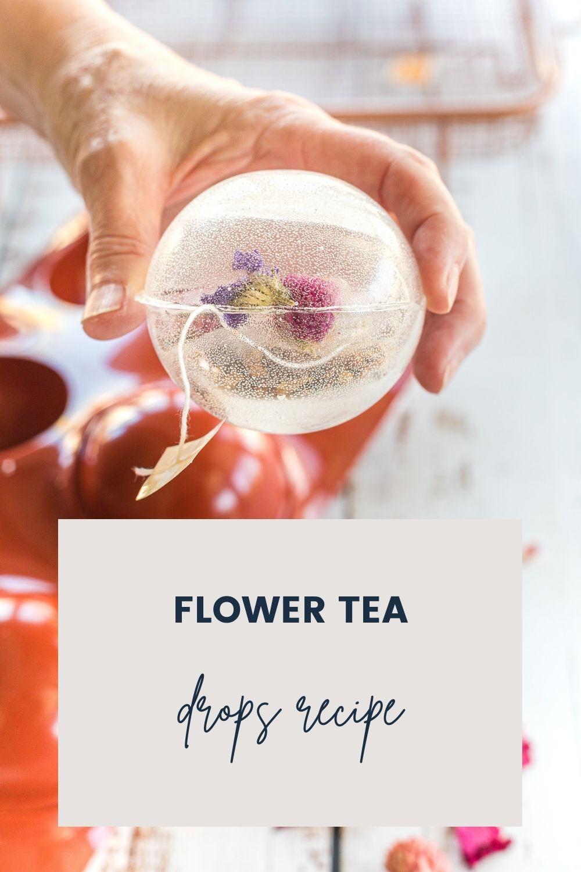 Holding a tea globe above a mug.
