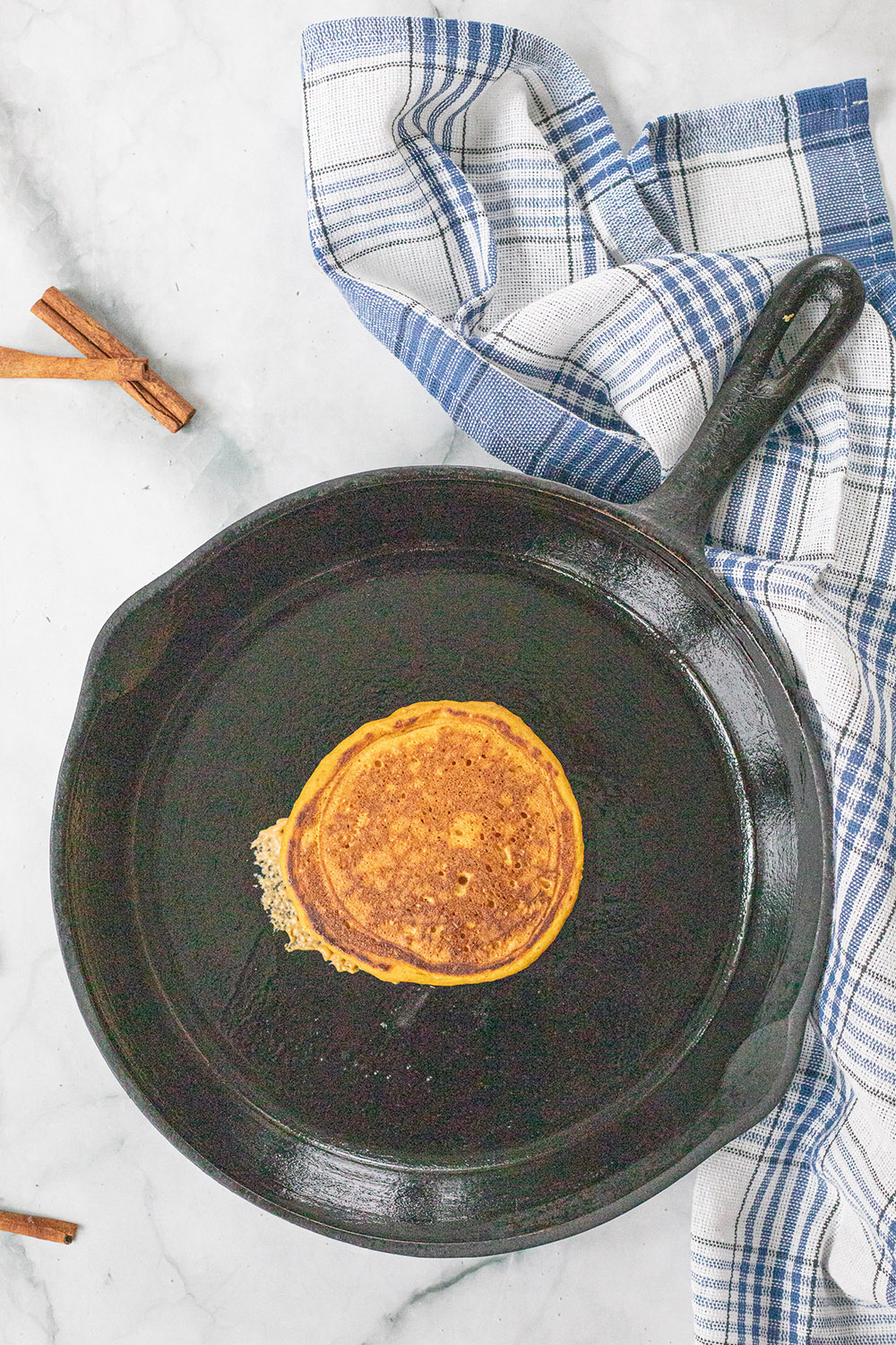 A pancake in a skillet.