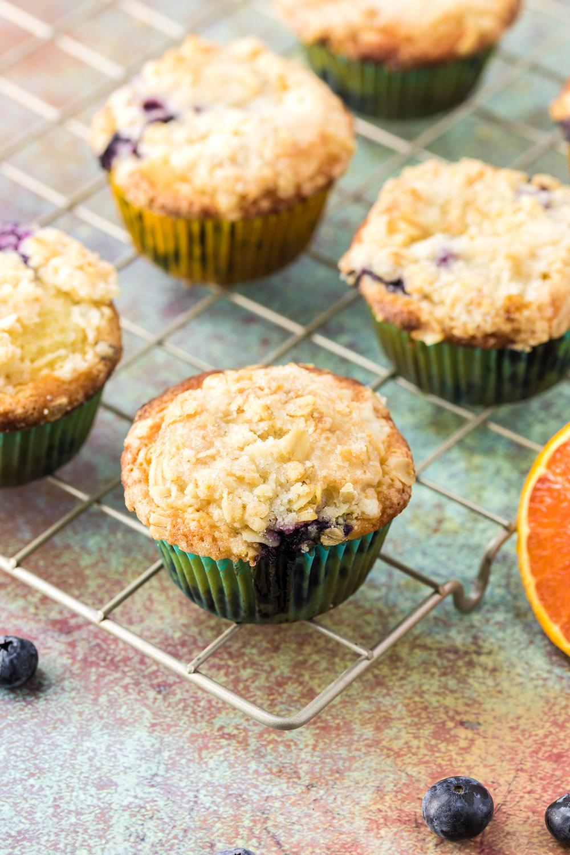 Blueberry orange muffins on a rack.