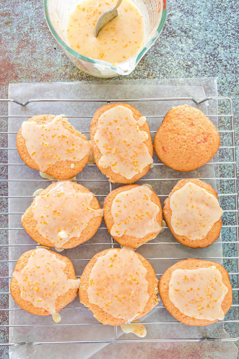 Orange cookies topped with carrot glaze.