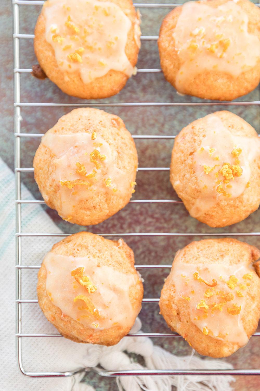 Orange juice carrot cookies on a cooling rack.