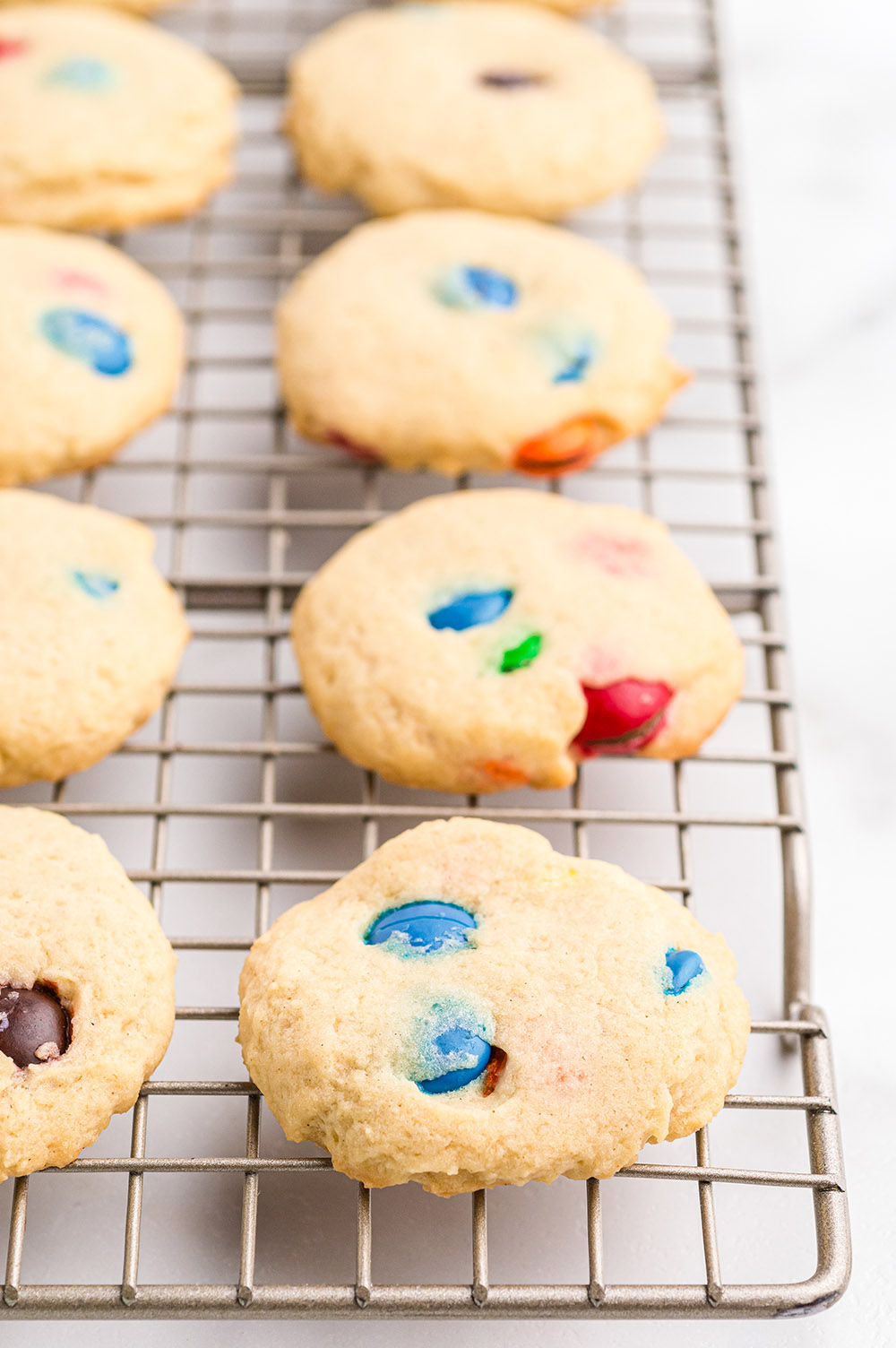 M&M Cookies on a cooling rack.