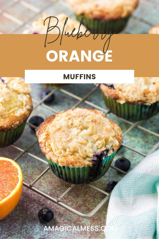 Orange blueberry muffins on a rack.