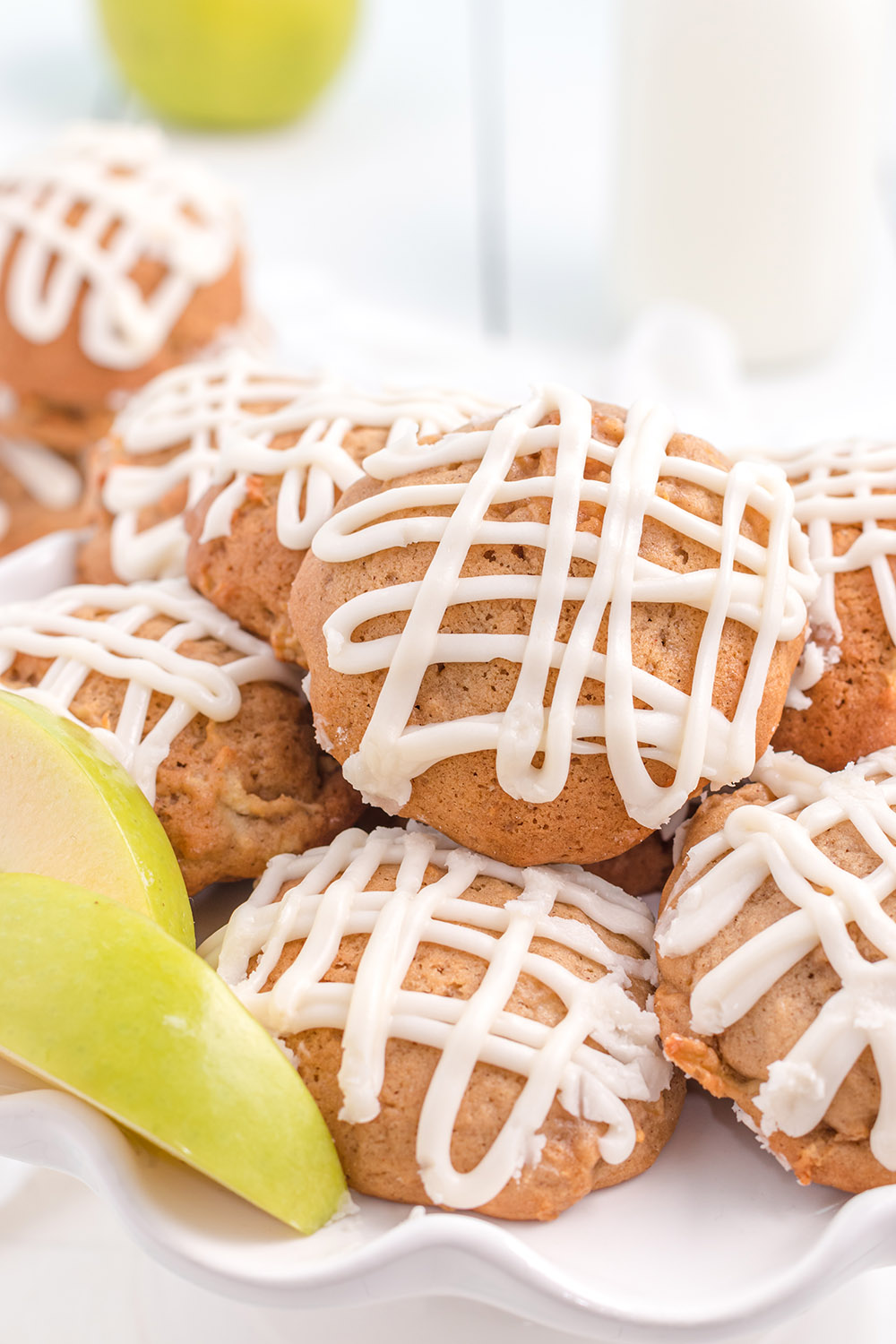 Plate of apple cookies topped with glaze.