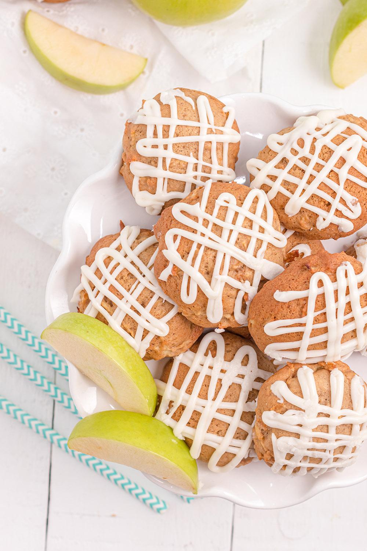 Glazed apple pie cookies on a plate.