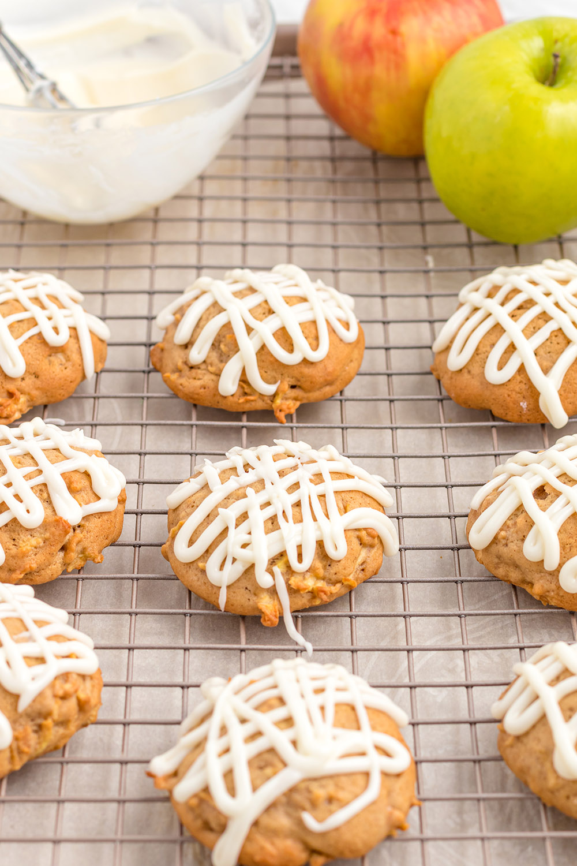 Glazed apple cookies on a rack.