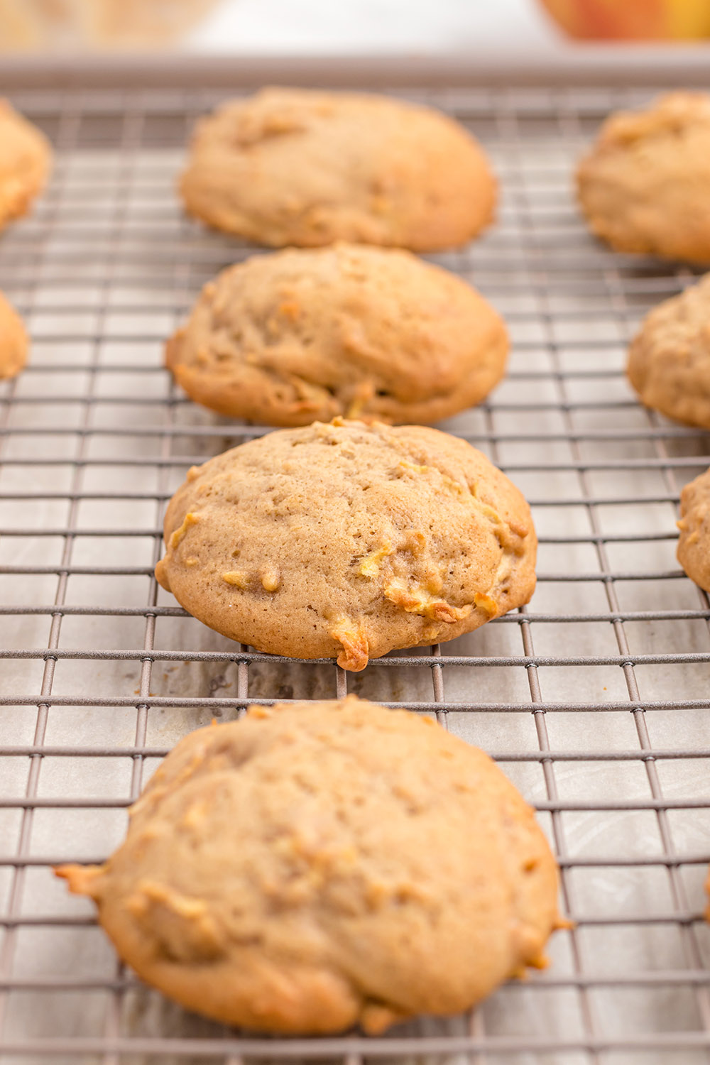 Apple cookies on a cooling rack.