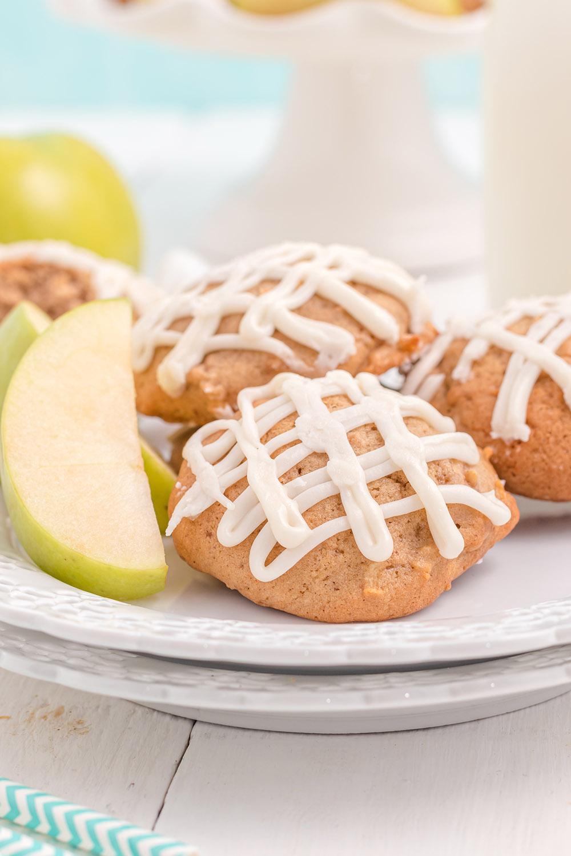 Glazed apple cookies on a plate.
