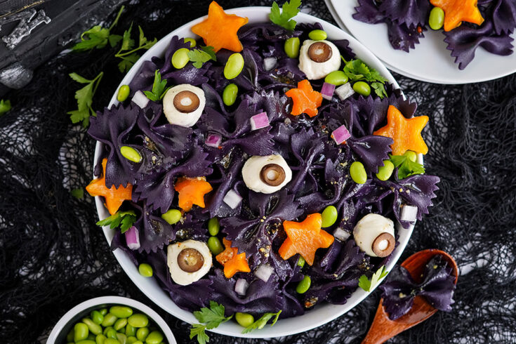 Overhead image of a Halloween pasta salad in a bowl.