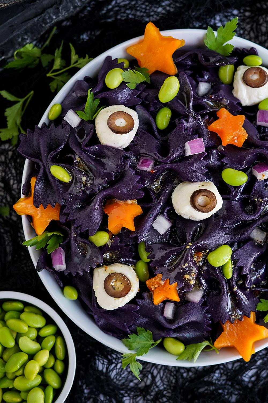 Closeup of bowl full of bat pasta salad for Halloween.