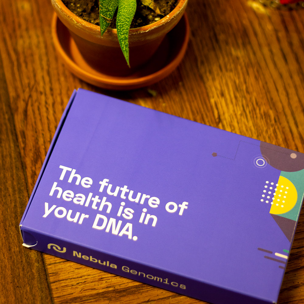 Nebula Genomics box on a wood table next to a succulent.