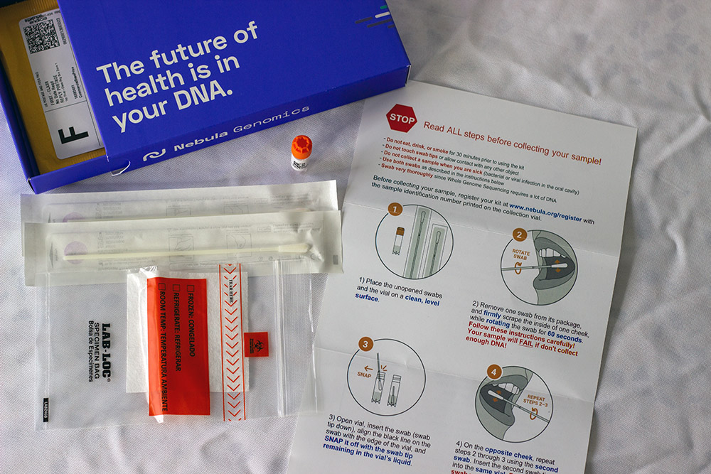 Contents of the Nebula Genomics DNA testing kit on a table.