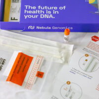 DNA test box contents on a white table.