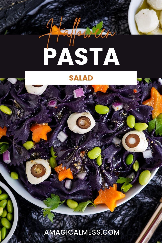 Orange, green, and purple veggies with dark pasta for a Halloween pasta salad.