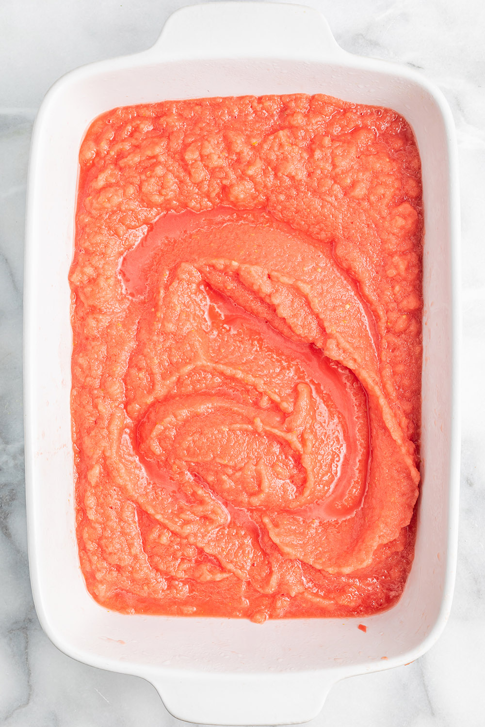 Blended watermelon in a white dish.