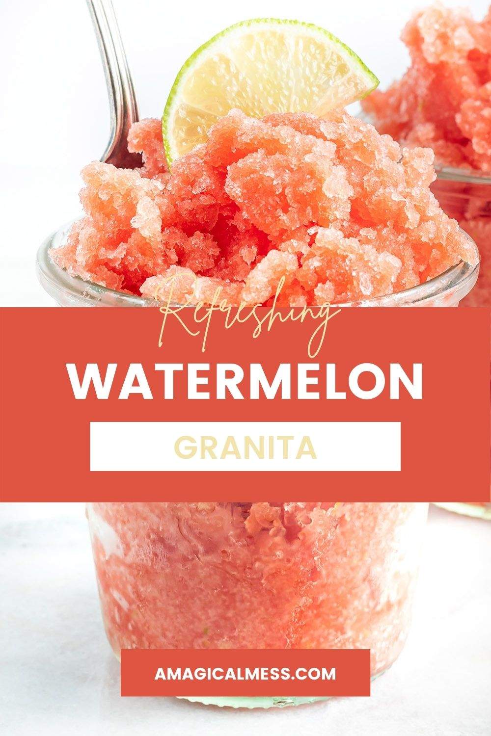 Cup full of watermelon granita with a lime on top.