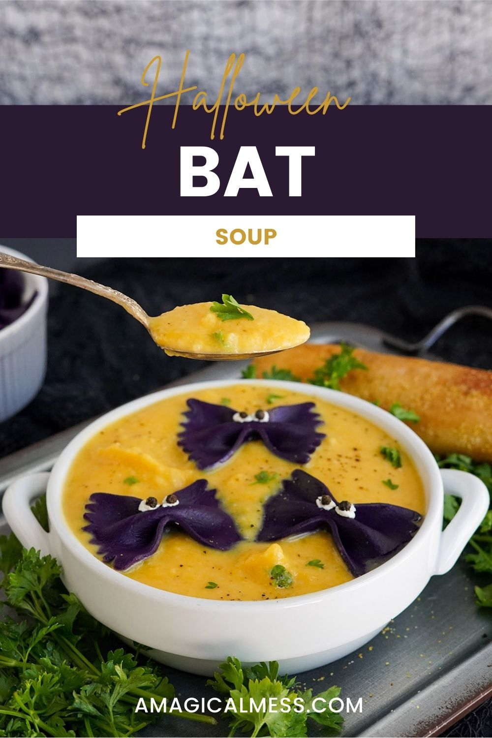 Bowl of butternut squash bat soup with a spoon raised above it.