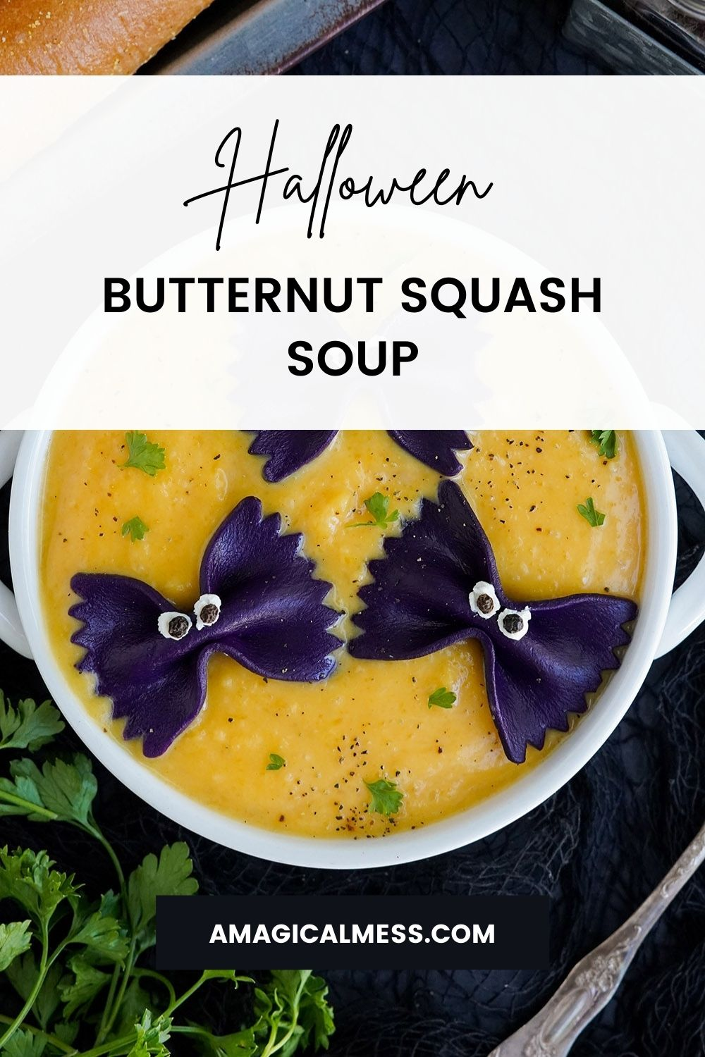 Bowl of butternut squash soup with black pasta to look like bats for Halloween.