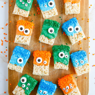 Rows of crispy treats decorated as monsters for Halloween.